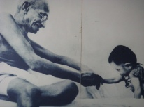 Gandhi w child smiling
