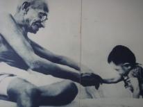 Gandhi w child smiling